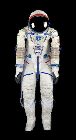 A flown space suit from the International Space Station (ISS) Expedition 6 / Courtesy of Bonhams