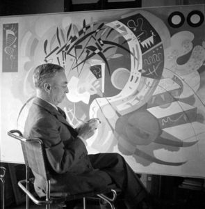 """Kandinsky in his apartment-studio in Paris (1939), before """"Dominant Curve"""" (1936), one of the most representative works of his Biomorphic Abstractions / Courtesy of musings-on-art.org"""