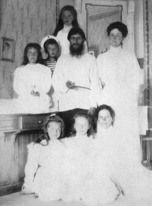 Alexandra Feodorovna with her children, Rasputin and the nurse Maria Ivanova Vishnyakova who later claimed that Rasputin had raped her, photo from McManus-Young Collection (1908)